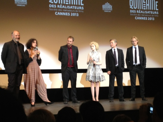 Jim Mickle & cast stand by as their intro is translated to the French audience