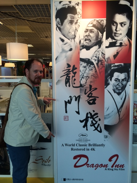 Colin in front of the Dragon Inn poster