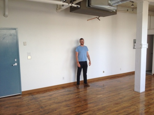 South facing. Jay is standing roughly where YOUR workspace could be, against the south wall and facing the wall of windows.