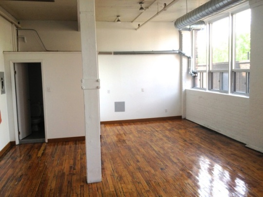 West facing. The far wall is roughly where Jay's workspace will be.