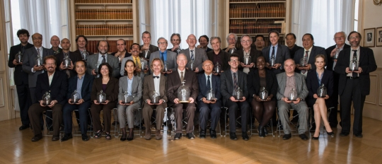 people of the world holding kilogram prototypes of the world