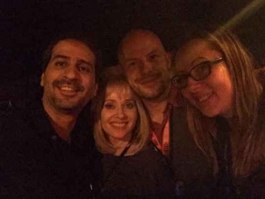 a dark photo of Alejandro Brugues, Barbara Crampton and Ted Geoghegan of We Are Still Here, and me