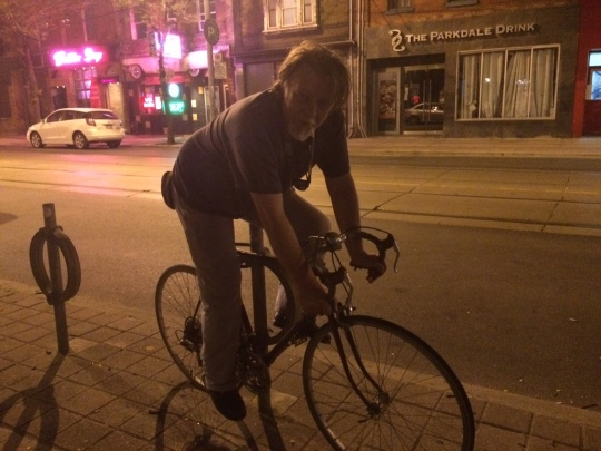 sound guy Steve rides a parked bike around 4am