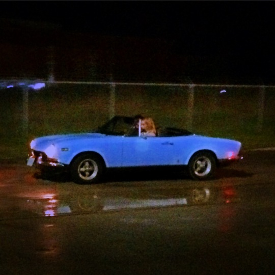 beautiful (cold) woman in vintage Fiat Spider
